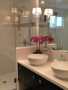 Take a cue from your favorite designers. Finding inspiration in Candice Olson's bright, fun designs, RMR user Luka82271 turned an out-of-date bathroom with an awkward toilet alcove into a light, airy space with a sweet feminine touch.