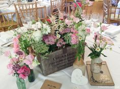 A stunning 'Natural' summer table centre design by top Bristol Florists, The Wilde Bunch at Maunsel House using wild 'cottage garden' flowers and antique stone bottles and boxes. Table Centers, Florists, Bristol, Summer Wedding, Centre, Wedding Flowers, Bottles, Cottage, Table Decorations