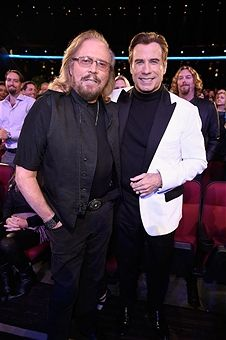 Singer Barry Gibb (L) and actor John Travolta attend 'Stayin' Alive: A GRAMMY Salute To The Music Of The Bee Gees' on February 14, 2017 in Los Angeles, California.