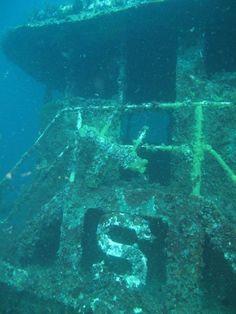 Find a sunken ship while chartering a scuba dive..