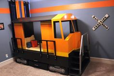Adorable train modeled bed! Who knows how long the train obsession will last, maybe it would be a keeper reading nook when they grow up.