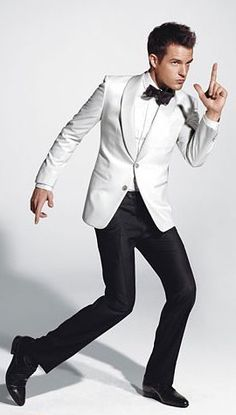 A twist on the tux! white jacket with black pants...fab!