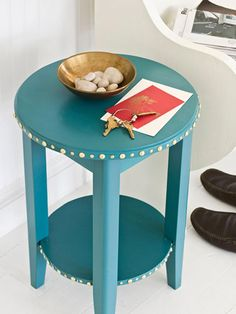 Decorate a table with tacks. Buy tacks from a hardware or fabric store for about $10 a pack (we used two packs in two sizes); push or tap them in along the lines of a table, bench, or chair for an eye-catching accent.