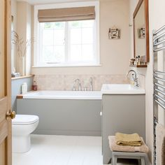 Bathroom with sage green accents    Sage green painted on the bath panel and vanity unit brings a modern feel to this neutral bathroom. Caramels and soft pinks are a warm version of a neutral palette. #bathroom #toilet #shower