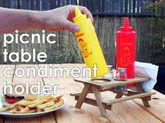Keeping your condiments corralled at a cookout is a central concern. This condiment contraption has been around for ages, and here's a new take on this classic design.This intermediate woodworking project is a great Woodworking Nightstand, Outdoor Picnic Tables, Condiment Holder, Spice Shaker, Wood Craft Patterns, Good Times Roll, Project Board, Wood Glue, Hot Sauce Bottles