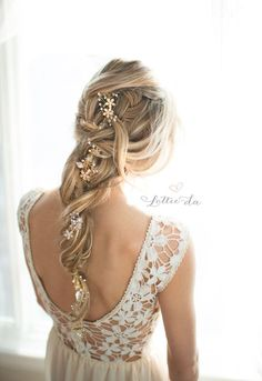 Stunning loose braid twisted wedding hairstyle with gold flower hair vine; Featured Hairpiece: Lottie Da Designs