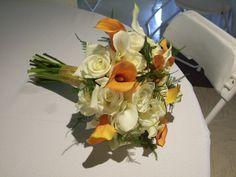 Bridal bouquet - white roses, white and orange mini calla lillies, w/ a touch of plumosa fern