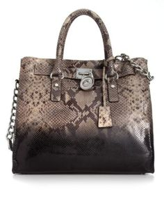 Showcase your penchant for python with this undecidedly posh, leather-embossed design from MICHAEL Michael Kors. Exquisite signature accents in shiny silvertone dress the outside, while the spacious interior provides plenty of pockets to organize your essentials.