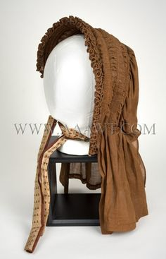 Brown cotton, caned, drawn bonnet, all original.