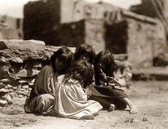 You are viewing an important image of Hopi Children at Play. It was taken in 1905 by Edward S. Curtis.    The picture shows a wonderful view of these young children.    We have created this collection of pictures primarily to serve as an easy to access educational tool. Contact curator@old-picture.com.    Image ID# B0AF90A2