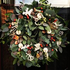 Nordic theme with wooden reindeer www.johicksflowers.co.uk. Check out our website to book our wreath making class for this Christmas. Christmas Floral Designs, Wooden Reindeer, Wreath Making, Nature Decor, How To Make Wreaths, Greenery, Christmas Wreaths, Website, Holiday Decor