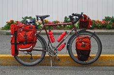 Gearing up for a long haul. | This bike and gear are not for weight weenies lol Nice Surly bike and packs! #biketouring