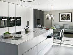 Modern kitchen design with large island and adjoined dining table. Handleless kitchen cabinets in Signal White Matt Lacquer with Dark Stained Oak contrast. Worktops in stainless Steel and Compac Absolute Blanc Composite Stone. Handleless Kitchen Cabinets, Kitchen Design Open, Luxury Kitchen, Contemporary Kitchen, Kitchen Design Modern White, New Kitchen, White Modern Kitchen, Kitchen Style, Kitchen Living