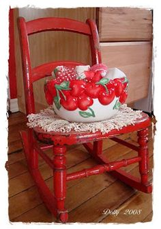 A red rocking chair with a cherry bowl! YES! I want this in my red, white, blue and yellow cottage.