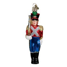This character from the Nutcracker Suite Ballet comes to life in Clara's dream. The fanciful clash of the Nutcracker and his troops against the Mouse King and his followers is one of the highlights of the Christmastime ballet which has charmed generations. #nutcracker #toysoldier #christmas #christmastime #ballet #christmastraditions #glassornaments #oldworldchristmas  Toy Soldier (Item #44009)