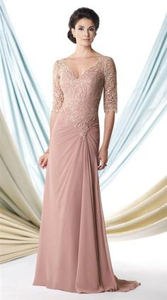 Dusty Rose Gown @Jamie Hendershot Trading Co A plummeting V neck neckline and lace bodice with elbow length sleeves provides an elegant flirtatious feel. Beaded accents and side-gathered skirt evoke an air of supreme sophistication. A sweep train provides the illusion of floating in this transcendental gown.