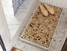 LOOKS LIKE I NEED TO DRINK MORE WINE!-- How to Make a Wine-Cork Bath Mat  Cork makes a wonderful surface for freshly washed feet because it's soft and porous, and absorbs water without developing mold or mildew. – Danny Seo