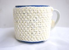 Hand knitted pastel yellow with white cup cozy