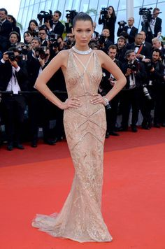 Cannes Film Festival 2016 Red Carpet. Bella Hadid stunned in Cavalli Couture nude gown accessorized with a statement silver choker by De Grisogono.