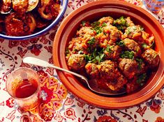 """Use eggplant instead, making Moroccan """"Italian baked eggs"""" with eggplant and cilantro. This recipe for Kefta Mkaouara—Moroccan meatballs—is cooked in a spicy tomato sauce. Eggs are an optional but classic addition to this dish. Moroccan Tagine Recipes, Moroccan Dishes, Kefta Kebab Recipe, Tajin Recipes, Shrimp Recipes, Chicken Recipes, Moroccan Meatballs, Morrocan Food, Lamb Meatballs"""