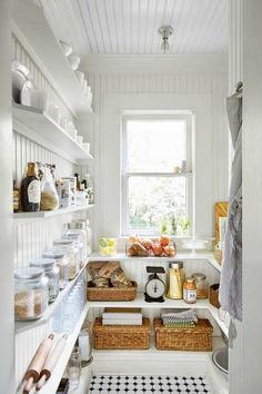 ~Like the beadboard on ceiling.and white of course :) ~Beadboard paneling and eye-pleasing open shelving take this utilitarian space from practical to pretty. Clear canisters and wicker bins keep (almost) everything in plain sight. Ideas Cabaña, Decor Ideas, Room Ideas, Pantry Inspiration, Monday Inspiration, Shelf Inspiration, Small House Decorating, Cottage Decorating, Decorating Ideas