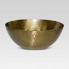 Serve up sophisticated style with this Threshold Hammered Large Serving Bowl with Gold Finish. With an interesting hammered texture, this gorgeous gold bowl has a lacquered finish, giving it a shiny appearance. Perfect for parties and events (indoors and out), this serving bowl holds chips, salads and more in a completely stylish way. You can also use it to display decorative items in the center of your dining table or kitchen island. Hand wash only.
