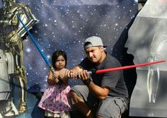 My son & Granddaughter having fun with the STAR WARS photo booth