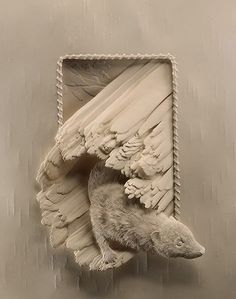 Canadian artist Calvin Nicholls creates beautiful sculptures using sheets of paper.'Calvin has been creating his paper sculptures since 1986 from his studio north of Toronto Ontario, Canada