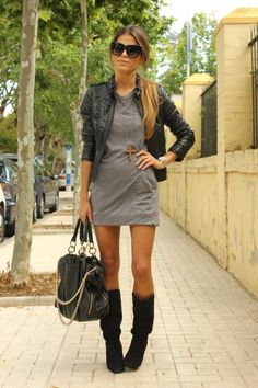Grey dress, leather jacket and black boots.