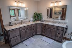Master Bathroom - Hamburg NY. Cabinetry by Haas - Federal Maple Slab. Cambria Quartz counter, Toto Sinks
