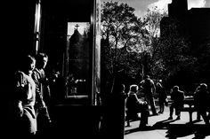 Trent Parke, A smoking couple walk past the bus stop at Town Hall. From Dream Life series. 2002.