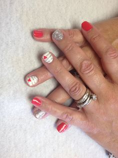 Coral with silver glitter and white with silver glitter lines and coral heart design on accent nails  Oasis Salon and Spa Mill Hall Pa (570)726-6565