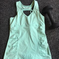 Kyodan Tank This is a Kyodan workout tank in mint green. It is a Medium in excellent used condition. Super cute spring color! Kyodan Tops Tank Tops