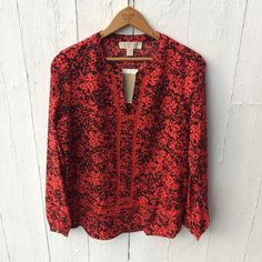 MICHAEL Michael Kors Coral & Black Eyelet Top Silky coral and black leaf pattern shirt with an intricate latter eyelet detailing on the front. Cuffed long sleeves with gold MK button. Quality material. Very Work Week Chic!❤️ NO TRADES MICHAEL Michael Kors Tops Blouses