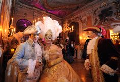 "People in costume arrive at the Palazzo Pisani Moretta during the historic ""Doge Ball"" in Venice"