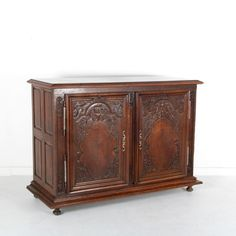 Beautifully hand-carved and hand-crafted, French antique, 19th Century, dark oak French buffet with two doors. In good original condition. Lovely patina and age marks. 65″ Wide x 26″ Deep xKeep reading…