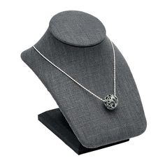 This compact mini pendant bust is ideal for areas where space is at a premium. The contours of the bust allows customers to see how necklaces and pendants will look when worn; with its low profile, it will fit easily in most display cases. The dark gray fabric has a subtle, natural texture well suited to contemporary designs. Two wire tabs on the back of the display secure excess chain, allowing you to neatly adjust the displayed pendant to the perfect length, offering an elegant… Fabric Display, Rio Grande Jewelry, Bold Jewelry, Display Cases, Gray Fabric, Contours, Contemporary Jewellery, Mini Pendant, Natural Texture