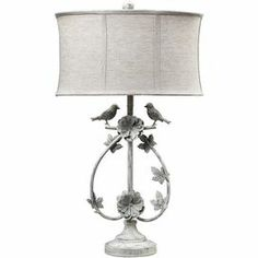"""Iron table lamp in distressed white with rosettes and bird accents.  Product: Table lamp   Construction Material: Iron and fabric     Color: Distressed white   Features:   3-Way switch   Naturally-inspired bird and branch design           Accommodates: (1) 100 Watt medium base bulb - not included Dimensions: 31"""" H x 18"""" Diameter"""