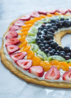 Rainbow Fruit Pizza with Crescent Roll Crust! This recipe is colorful, full of flavor and great for outdoor summer entertaining.