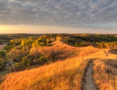 The sun sets over the Loess Hills in Monona County. (Photo by Robert Buman) #Iowa #Loess_Hills