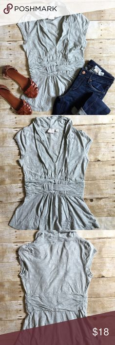 🎉SALE🎉 POSTMARK Blue Gathered VNeck Tee Gorgeous gathered details on this Anthropology v neck tee! Pair it with jeans, shorts, skirts! Has a small hole at the bottom as pictured otherwise great condition! Anthropologie Tops
