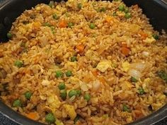 Easy fried rice, better than takeout! 3 cups cooked rice, 3 tbs sesame oil 1 cup frozen peas and carrots (thawed) 1 small onion, chopped 2 tsp minced garlic 2 eggs, slightly beaten 1/4 cup soy sauce