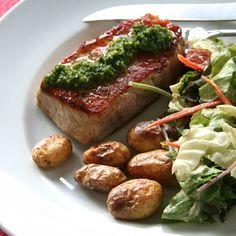 Seared Pork Chops with Garlic Scape Chimichurri- a quick & full-flavored dish using a wonderful seasonal ingredient