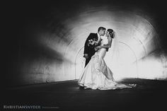 I took this photograph in a dark tunnel with light coming in the far end. Made for a beautiful photograph of the bride and groom!