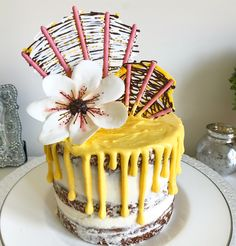 Create chocolate fan decorations with pocky sticks and wilton candy melts. Super easy to do and you create the tall 3D cake decorations that are all the rage ! Check out the YouTube tutorial for more info