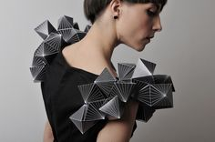 Geometric shoulder pads, made from paper most probably made using a template.