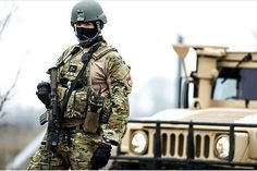 Hungarian Defence Forces soldiers at HMMWV. Motorcycle Jacket, Military Jacket, Military Special Forces, Defence Force, Military Photos, Army Soldier, Kingsman, Hungary, Air Force