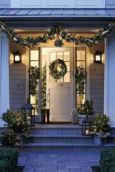 festive porchway with wreaths and green foliage