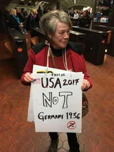 """Maggie Gaffen of Arlington, Va. said she thinks the country is heading in the direction of Germany in 1936.She said what she has heard from President Donald Trump terrifies her -- """"and the fact that nobody in Congress has got the backbone to fight them.""""Gaffen said the Trump presidency """"is going to affect us all.""""Gaffen was photographed in the Crystal City subway station in Arlington on her way to the Women's March on Washington,  Saturday, Jan. 21, 2017."""