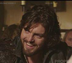 Athos smiling